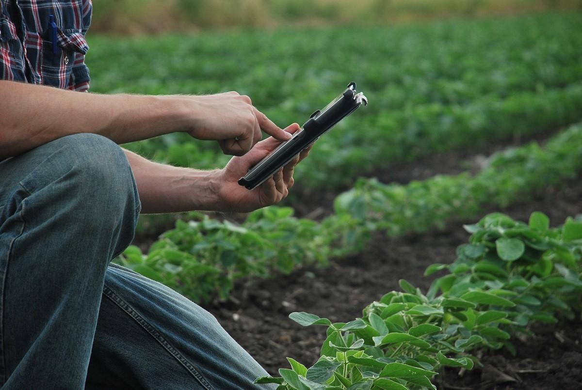 Eric (a farmer) is holding an iPad